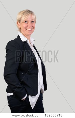 successful and beautiful european mature woman in business dress, side view - photograph, isolated on light background