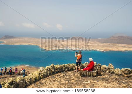 Mirador del Rio Lanzarote March 31 2017: People enjoing Impressive view from Mirador del Rio to island of La Graciosa Lanzarote Canary islands