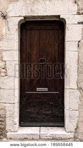 Wooden door in a old stone doorway entrance