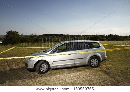 Crime scene investigation - abandoned car in barrier tapes