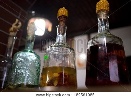 Traditional ukrainian GORILKA alcoholic drink in bottles plugged by corncob