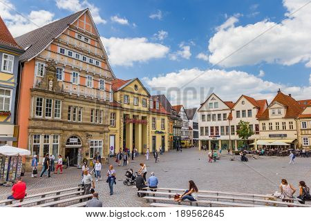HAMELN, GERMANY - MAY 22, 2017: People shopping at the colorful central market square of Hameln, Germany