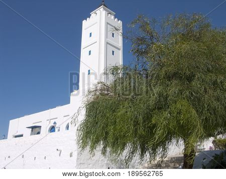 A white church in tunis with a blue sky