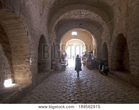 Woman walking in Tunis city with beautiful architecture
