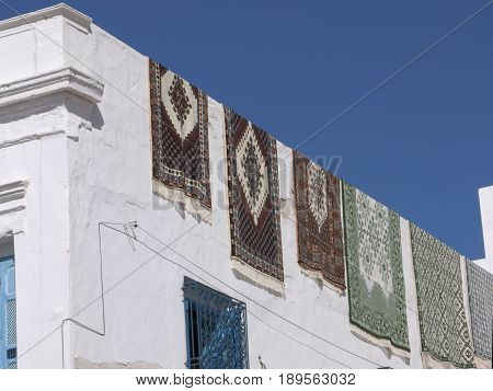 carpets hanging on Arabic house in Tunis