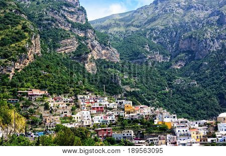 Scenic view of the village of Positano in Italy nestled in the mountain-side