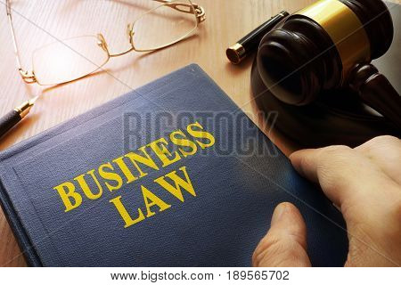 Business law on an office table and gavel.