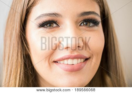 Satisfied With Her Makeup In A Salon