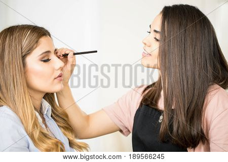 Makeup Artist Applying Some Eyeliner