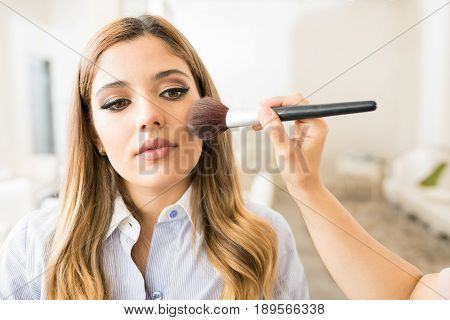Woman Getting Some Blush In A Salon
