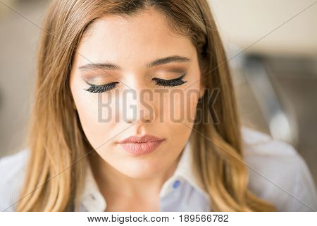 Woman Showing Her Makeup In A Salon