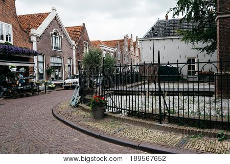 Monnickendam Netherlands - August 08 2016. Street view with old traditional houses in the dutch village of Monnickendam. The town was founded by monks and it is a small fishing village today