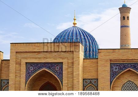 Medieval Central Asian mausoleum with oriental ornament blue dome and decorative arches