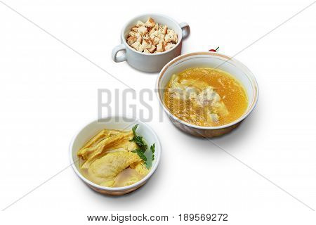 Soup with breadcrumbs on a white background isolation