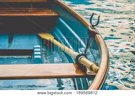Close up of an wooden pleasure rowboat at the pier of a lake. Boat rent on Alster. Hamburg. Germany