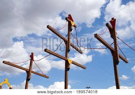 Wooden masts of the children's ship on a playground