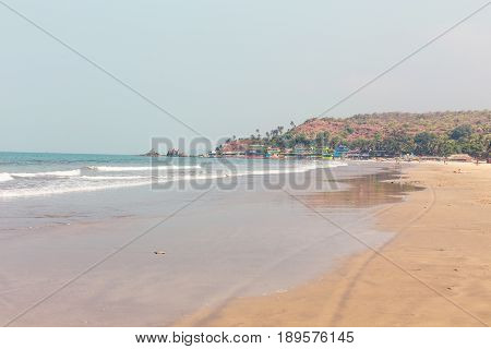 Goa India the beach of Arambol. Idyllic tropical beach coastline of the ocean resort area of the sea on a clear day. poster