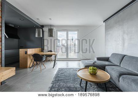 Gray Living Room With Balcony