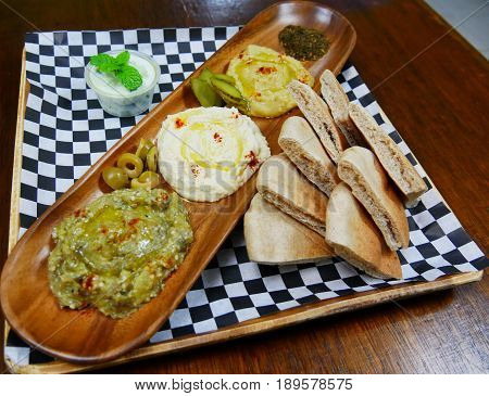 Mediterranean platter of nan bread and dips Mediterranean platter composed of slices of freshly made nan bread, dips of eggplant, humus and more