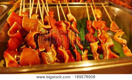 Pork ears barbeque Pork ears barbequed in a skewer is a very popular street food in the Philippines.
