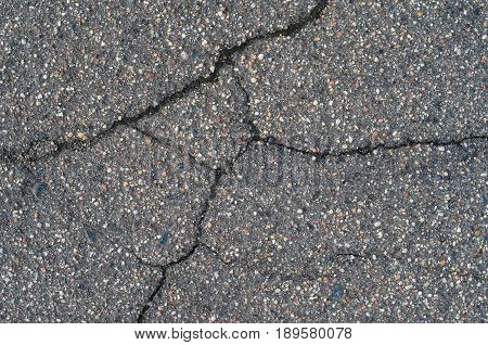 Asphalt texture with cracks. The texture of asphalt strongly cracked over time
