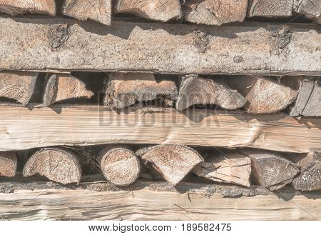 Woodpile from old firewood in a horizontal format