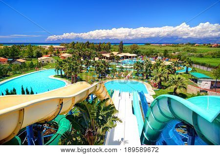 CORFU ISLAND, GREECE, JUN,01, 2014: Outdoor Greek Aqua park with water slides swimming pools for children. Greece islands holidays vacation travel tours. Water slides park. Aqua park
