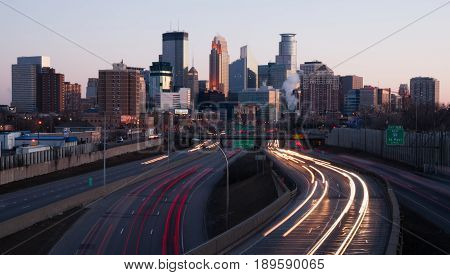 MINNEAPOLIS MINNESOTA/UNITED STATES - March 27: The highway carries rush hour commuters in and out of downtown at sunset on 03/27/2015 in Minneapolis.