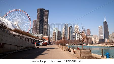 CHICAGO ILLINOIS/UNITED STATES - April 1: Navy Pier with it's carnival ride and view of the downtown city skyline 04/01/2015 in Chicago Illinois.