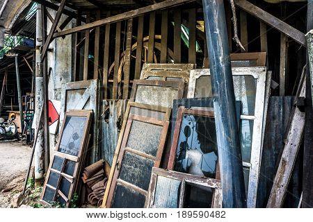 unused and abandon glass windows lean on wood plank photo taken in Jakarta Indonesia java