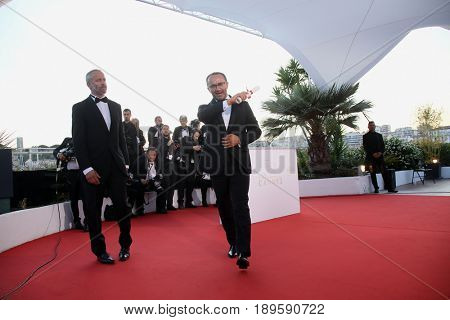 Andrey Zvyagintsev, who won the Prix Du Jury for the movie 'Loveless' (Nelyubov) attends the Palme D'Or winner photocall during the 70th Cannes  Festival at Palais  on May 28, 2017 in Cannes, France.