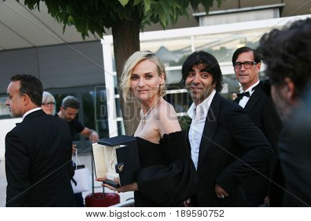 Diane Kruger winner of the award for best actress  and  Fatih Akin attend the winners photocall during the 70th Cannes Film Festival at Palais on May 28, 2017 in Cannes, France.