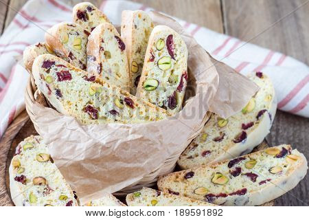 Biscotti with cranberry and pistachio in vine basket closeup
