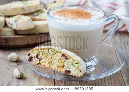 Biscotti with cranberry and pistachio with cup of coffee latte