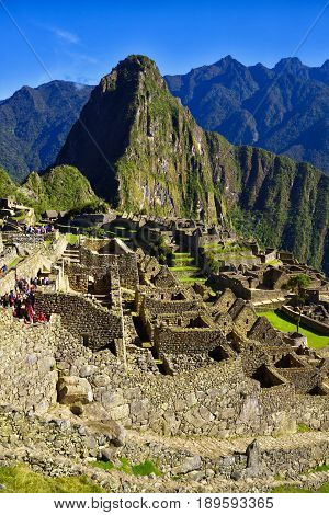 Machu Picchu, Peru - 13 Oct, 2016: View of the Lost Incan City of Machu Picchu near Cusco Peru. Machu Picchu is a Peruvian Historical Sanctuary. People can be seen on foreground.
