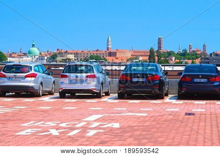 Venice, Italy, May, 26, 2017:car on a parking in Venice, Italy, There is no car traffic in Venice and all car owners have to park thier cars on the entrance of city