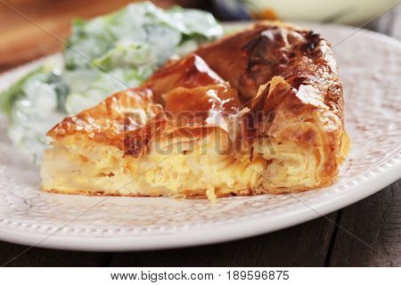 Phyllo pastry cheese pie served with yogurt salad