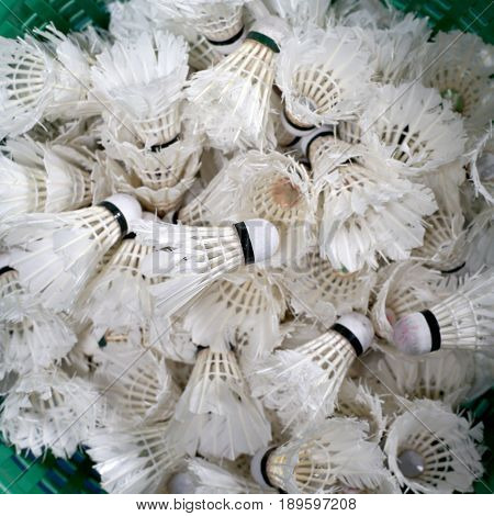 pile of used badminton shuttlecock in basket