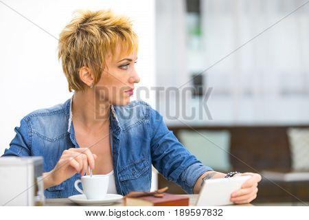 Thoughtful Young Woman Watching Something