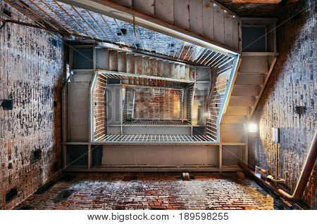 Staircase inside clock tower in Lucca with historic buildings in Italy.