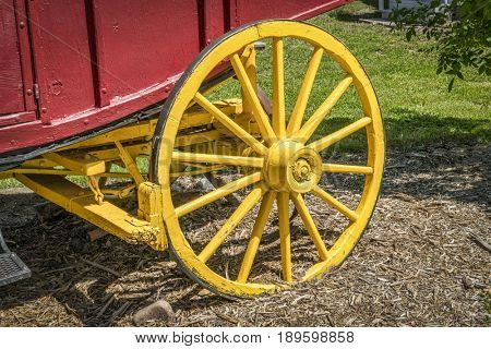 vintage wooden stagecoach wheel with a break