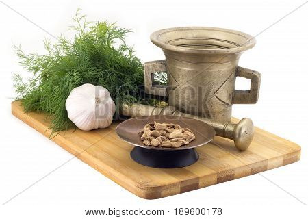 Composition Of Spices, Bengal Cardamoms , Dill, Garlic, Vintage Spice Grinder Isolated On White Back