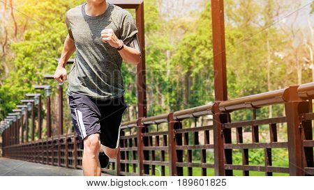 Unning Man. Male Runner At Sprinting Speed Training For Marathon Outdoors