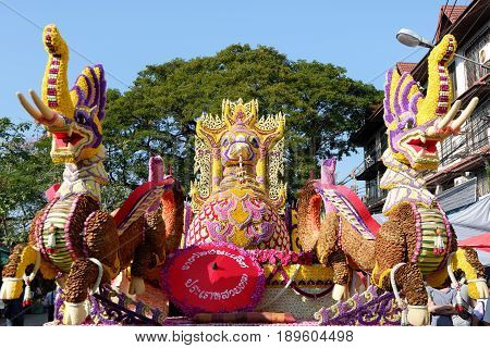 CHIANG MAITHAILAND-FEBRUARY 04 : The parade cars are decorated with many different kinds of flowers in annual 41th Chiang Mai Flower Festival on February 04 2017 in Chiang MaiThailand.