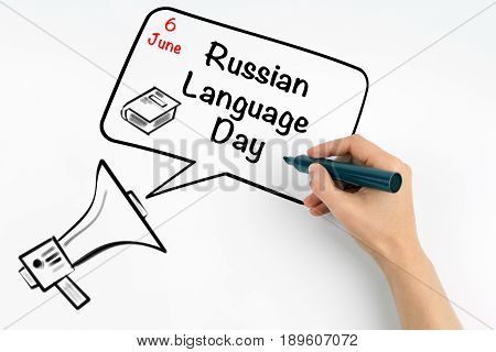 6 June Russian Language Day. Megaphone and text on a white background