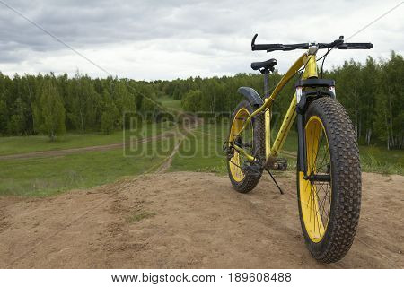 Fat bike - dirty bicycle outdoor, horizontal photo