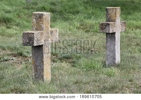 Two old nameless crosses in the military cemetery