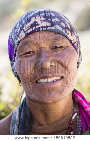 HIMALAYAS ANNAPURNA REGION NEPAL - OCTOBER 17 2016 : Unidentified old Nepalese woman with wrinkled face portrayed in a Himalayan village in Nepal