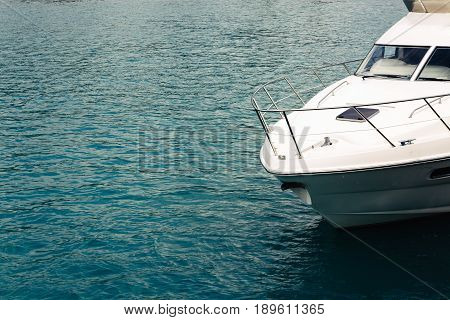 Yacht in the sea. The yacht's nose on the water Concept of travel and sea walks