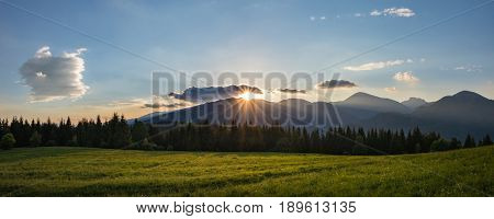 Panoramic View Of Amazing Mountains Sunset